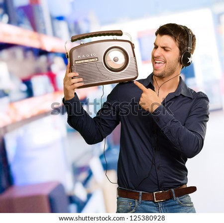 Young Man Enjoying Music, Indoors