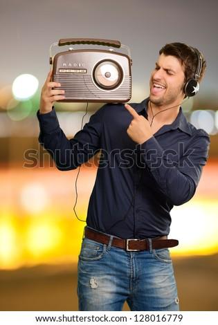 Young Man Enjoying Music, Outdoors