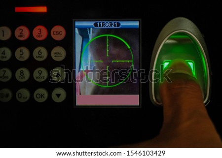 Young man entering code on alarm system keypad indoors #1546103429