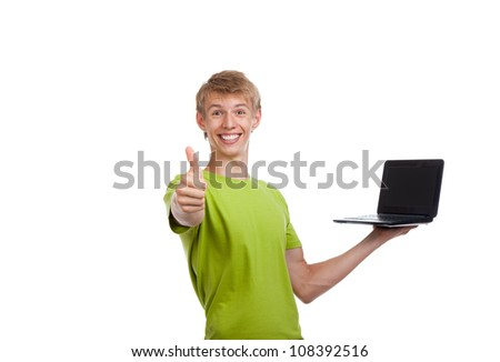 Young man excited smile hold laptop show hand thumb up gesture, looking at camera, casual wear green shirt isolated over white background, concept of present advertise
