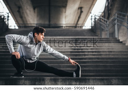 Young man exercise in urban environment #590691446