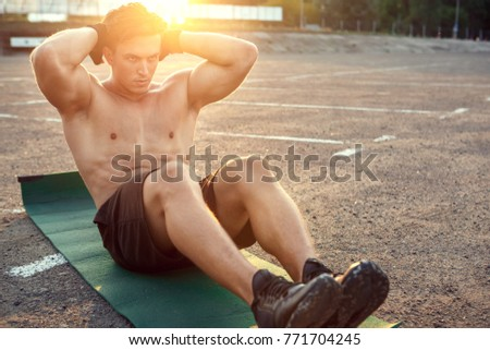 Young man exercise outdoors sport concept #771704245