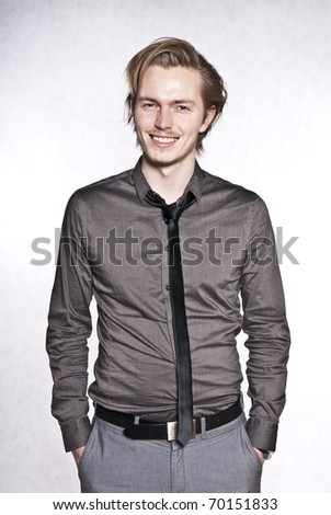 Young man expression portrait. Studio photo of young man making a funny face.