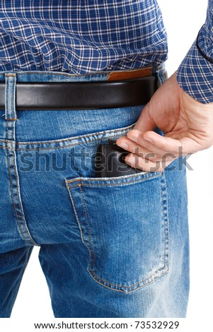 Young man extracting a wallet from his blue jeans.