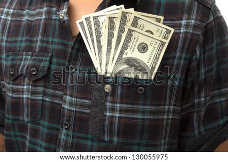 Young man extracting wearing a shirt and necktie with dollar in his front pocket.