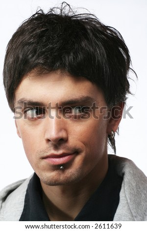 Young  man face with eyes looking on side. Doubt concept