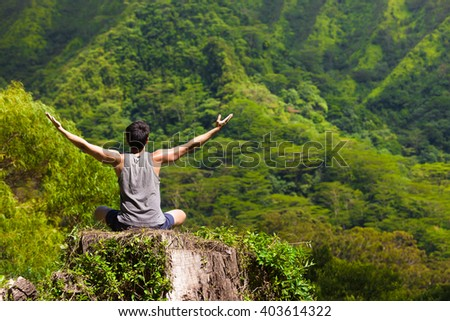 Young man feeling free in nature. Peace and relaxation concept.