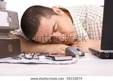 Young man, fell asleep on his table