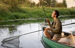Young man fishing on a beautiful lake