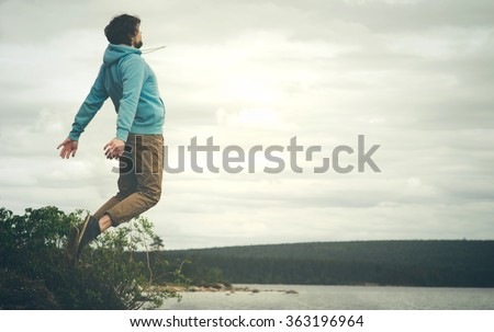 Young Man Flying levitation jumping outdoor relax Lifestyle Travel happiness spiritual concept moody colors