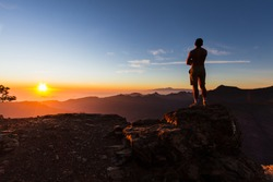 Young man gazing a beautiful landscape