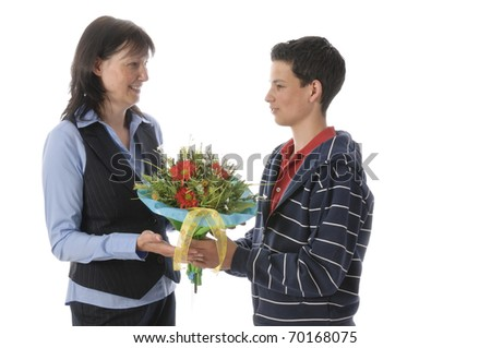 Young man gives his mother a large bouquet of flowers, isolated on a white background.