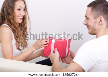 young man giving box  for his girlfriend, girl surprised