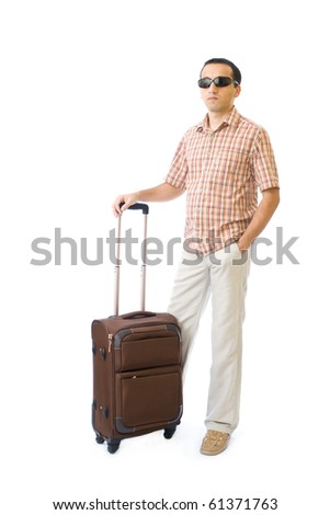 Young man going on a trip isolated on white