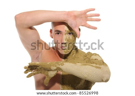 young man half smeared with clay isolated on white