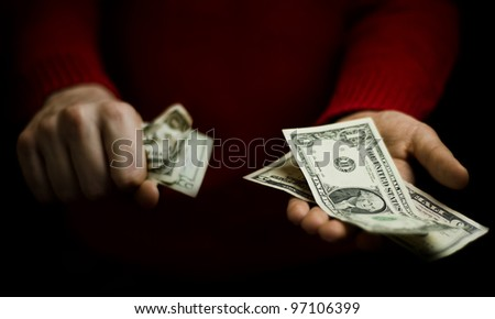 young man hands with money, holding with one hand and giving with another hand