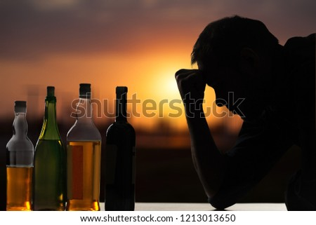Young man have troubles with alcohol.