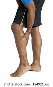 Stock photo of Young man having calf pain in a cropped image