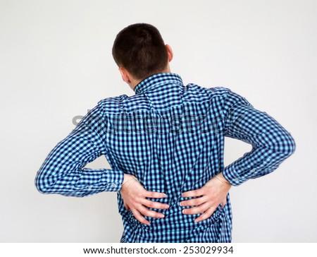 Young man having kidneys pain