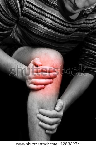 Young man having knee ache