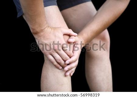 Young man having knee pain