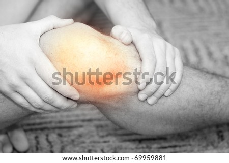 Young man having knee pain