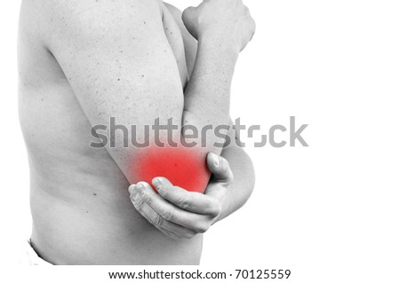 young man having pain in his elbow - stock photo