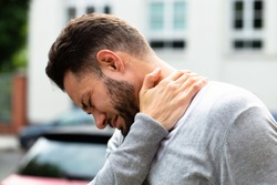 Young Man Having Pain In His Neck