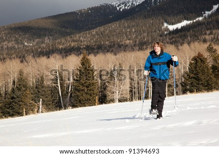 Young Man Hiking in Snowshoes