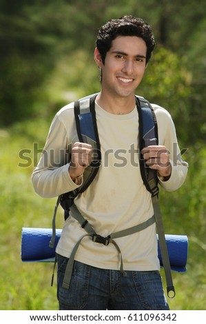 Young man hiking in the wilderness