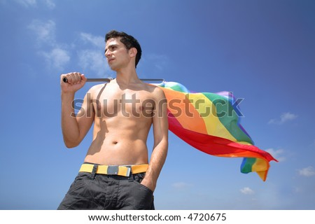 Young man hold a rainbow flag guy boy