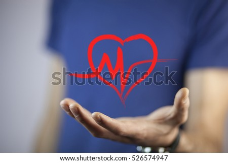 young man holding a heart in his hands #526574947