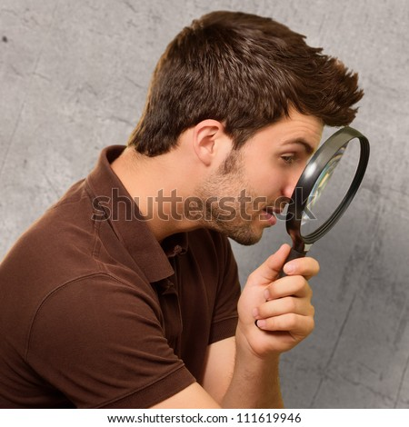 Young Man Holding A Magnifying Glass, Background