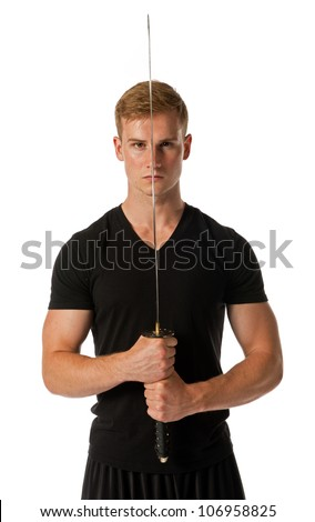 Young man holding a samurai sword isolated on a white background.
