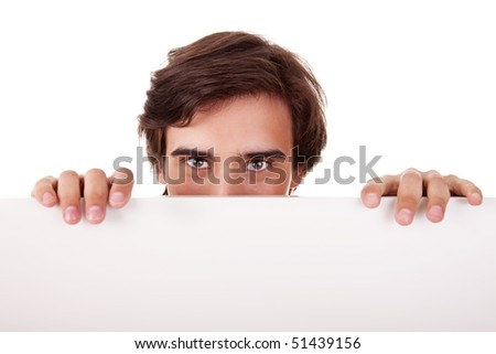 Young man holding a white board, looking to camera, isolated on white background
