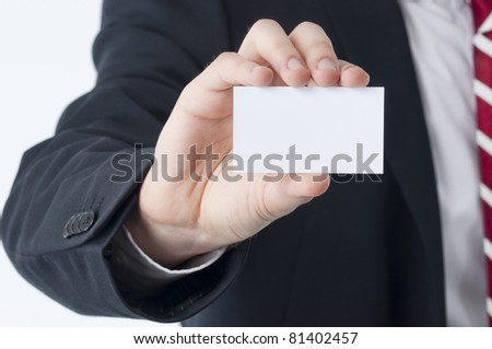 Young man holding an empty business card in his hand