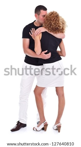 Young man holding and kissing his girlfriend - isolated