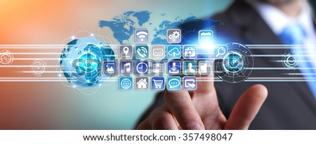 Young man holding application icons interface in his hand