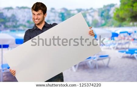 Young Man Holding Banner Gesturing, Outdoors