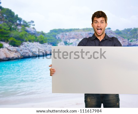 Young Man Holding Blank Paper, Outdoor