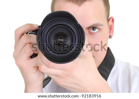 young man holding camera over white