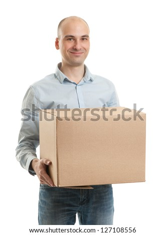 Young man holding cardboard box