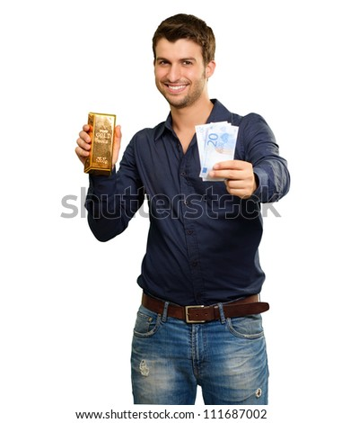 Young Man Holding Currency And Gold Bar On White Background