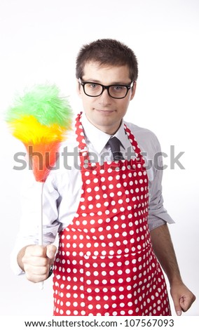 Young man holding duster.