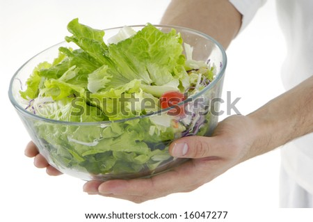 Young man holding fresh salad