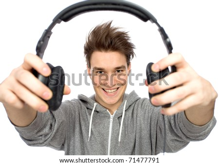 Young man holding headphones