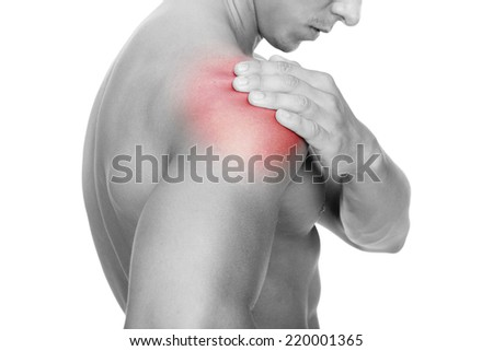 Young man holding his shoulder in pain, isolated on white background #220001365