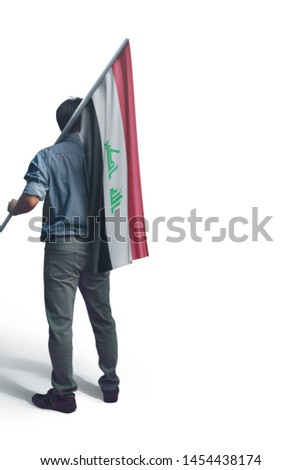 Young man holding Iraq Flag in White Background, Flag of Iraq.
