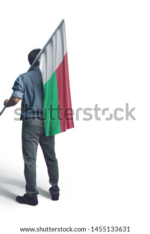 Young man holding Madagascar Flag in White Background, Flag of Madagascar