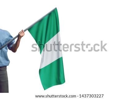Young man holding Nigeria Flag in White Background, Flag of Nigeria. #1437303227